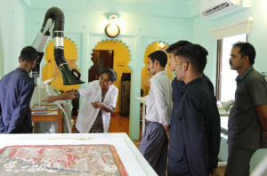 Attendants being introduced to the equipments in the conservation laboratory by the conservator